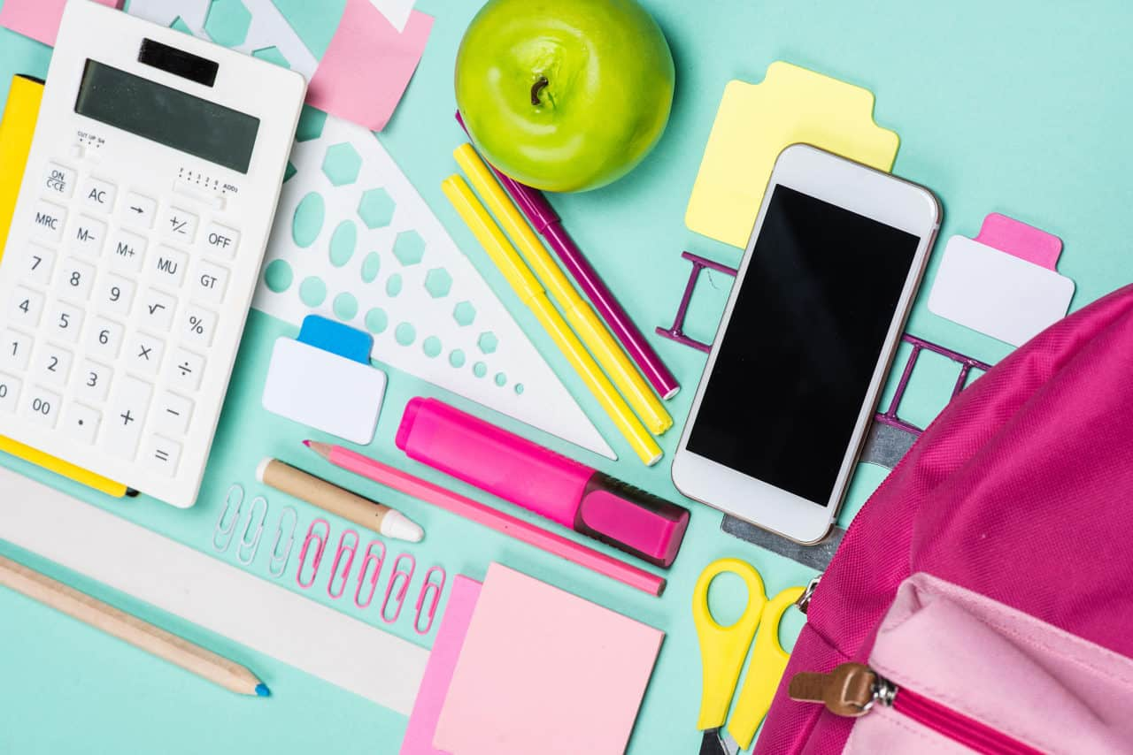 Close Up View Of Various School Supplies On Colorful Surface